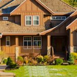 Fall Landscaping Tips- Large luxury home with blue sky in sunny autumn day