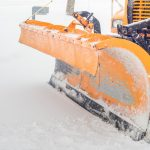 Snow plow moving snow- Stay Ahead of Winter with Snow Clearing